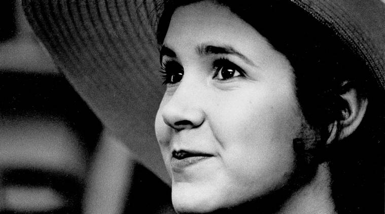 FILE - This May 2, 1973 file photo shows Carrie Fisher, the 16-year-old daughter of Debbie Reynolds and Eddie Fisher, in New York. On Tuesday, Dec. 27, 2016, a publicist says Carrie Fisher has died at the age of 60. (AP Photo/Jerry Mosey, File)