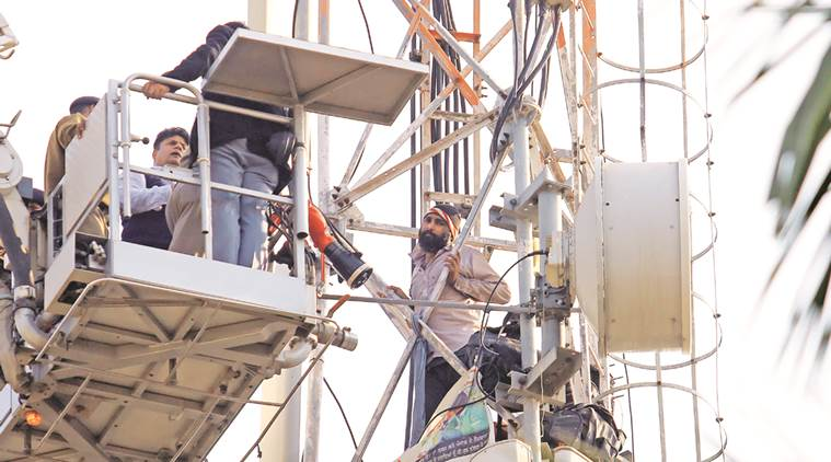 Teacher Deepak Kumar on the mobile tower in Sector 3 on Friday.  Kamleshwar Singh