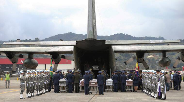 Air force members and police accompany caskets containing the remains of Brazilian victims who died in a chartered flight, to a waiting cargo plane at the military airbase in Rio Negro, Colombia, Friday, Dec. 2, 2016. The bodies of the Brazilian victims are being repatriated to Chapeco, the hometown of the Brazilian soccer team whose members were on the doomed LaMia flight along with a group of journalists, headed to the Copa Sudamericana finals. (AP Photo/Fernando Vergara)