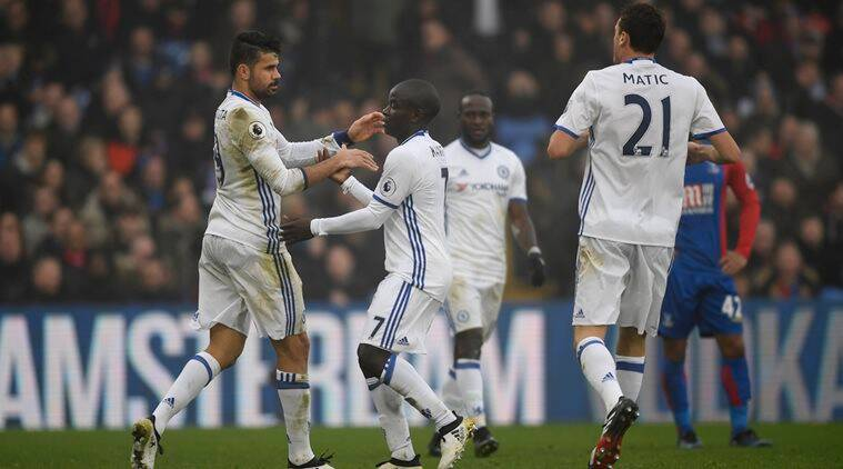 Chelsea's Diego Costa celebrates scoring their first goal with Nemanja Matic and N'Golo Kante (C)