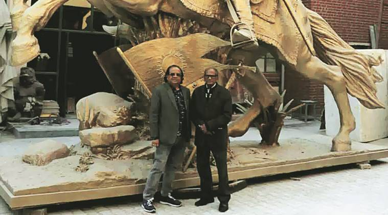 (Right) Anil Sutar and Ram Vanji Sutar with a replica of the statue. Express