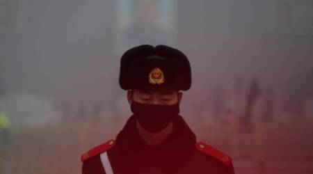 October factory growth seen easing slightly as smog war begins inChina
