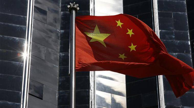 A Chinese flag is hoisted outside a commercial building in Shenzhen, China's southern Guangdong province
