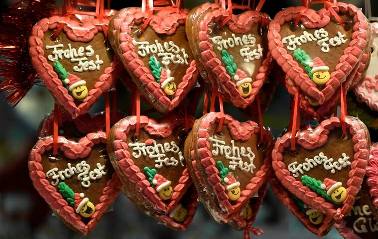Gingerbread, reading 'Happy Feast', is sold at a traditional Christmas market in the center of Muenster, Germany, Thursday, Dec. 8, 2016. (AP Photo/Martin Meissner)