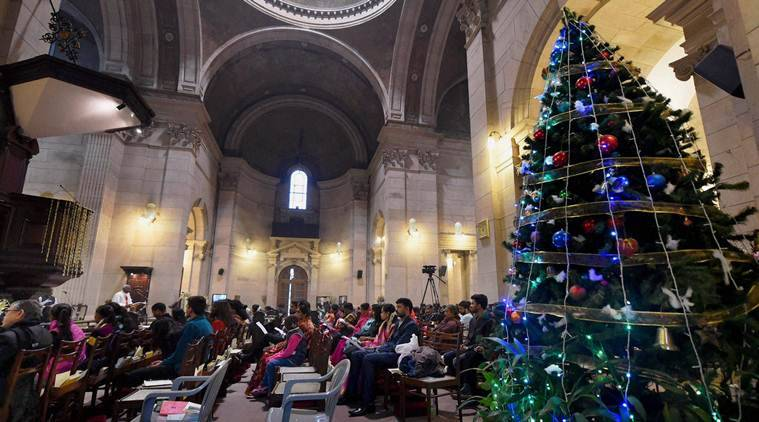 New Delhi: Devotees offer prayers on the occasion of Christmas  at the Cathedral Church of the Redemption in New Delhi on  Sunday. PTI Photo by Shahbaz Khan(PTI12_25_2016_000017A)