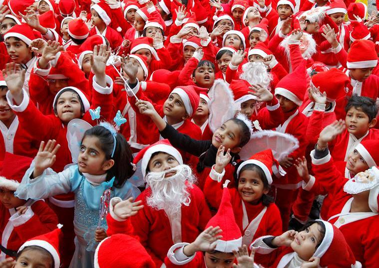 Children dressed in Santa costumes participate in Christmas celebrations at a school in Chandigarh, India, December 24, 2016. REUTERS/Ajay Verma