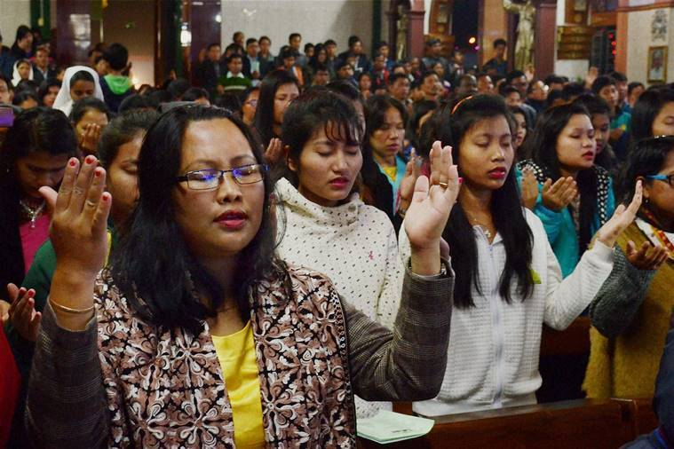 Tripura: Devotees offer prayers at a church on the occasion of Christmas in Agartala, Tripura on Saturday. PTI Photo(PTI12_25_2016_000013B)