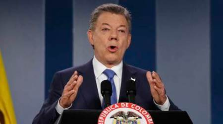 Colombia's President Juan Manuel Santos delivers a statement to the press after meeting with former President Alvaro Uribe and other opposition leaders at the presidential palace in Bogota, Colombia, Wednesday, Oct. 4, 2016. Uribe was a vocal critic of a peace deal signed between the Colombian government and rebels of the Revolutionary Armed Forces of Colombia, FARC, and led a successful campaign for voters that narrowly reject the deal in a referendum, delivering a major setback to Santos.  (AP Photo/Fernando Vergara)