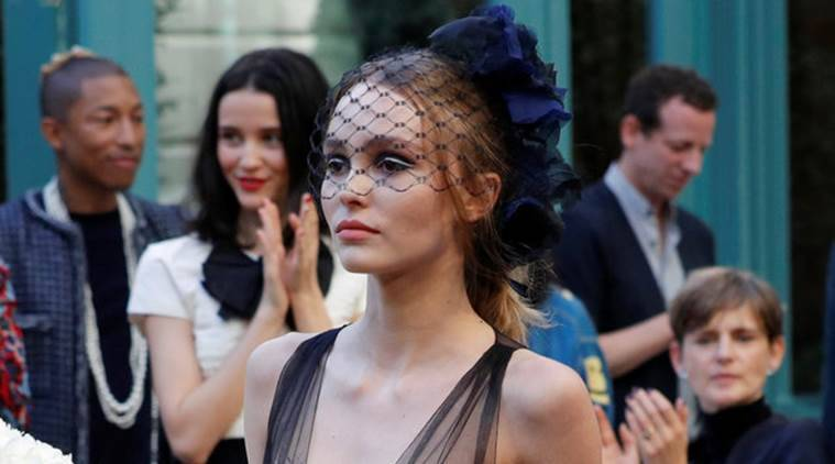 Actress Lily-Rose Depp presents a creation with a Paris Cosmopolite theme by designer Karl Lagerfeld during the Metiers D'Art Show for Chanel fashion house in Paris. (Source: Reuters)