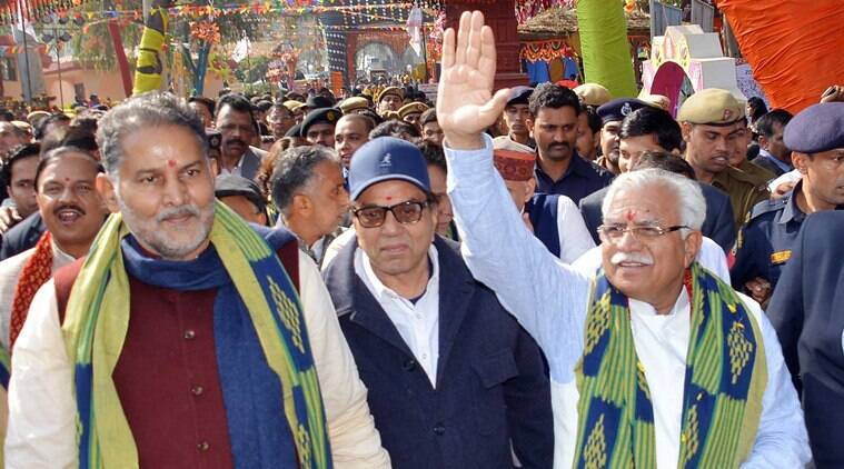 Haryana Chief Minister Manohar Lal responding to the greetings of the people after inaugurating the 30th Surajkund International Crafts Mela 2016 accompanied bybrand ambassador of Haryana Tourism, Dharmendra and Tourism Minister Ram Bilas Sharma at Surajkund in Faridabad on Monday, February 01 2016. Express Photo