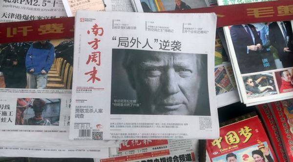 "In this photo taken Thursday, Nov. 10, 2016, a front page of a Chinese newspaper with a photo of U.S. President-elect Donald Trump and the headline ""Outsider counter attack"" is displayed at a newsstand in Beijing, China. China's foreign minister on Thursday, Dec. 22, 2016 warned that ties with the U.S. will likely see new complications and that the only way to maintain a stable relationship is by respecting each other's ""core interests."" (AP Photo/Ng Han Guan)"