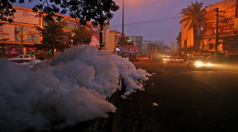 As Bengaluru awaits New Year celebration, residents near Varthur Lake face yet another nightmare as the toxic froth spills out to state highway 35. The toxic effluents that cause the froth build up are deposited by Garment units upstream and other apartment buildings in the area functioning without a sewage treatment facility. Over the years the, these effluents have completely killed the habitat and helped in mosquito breeding. Reports also shows contamination of groundwater in the area which results in several diseases spreading. Express photo by Nirmal Harindran, 30th December 2016, Mumbai.