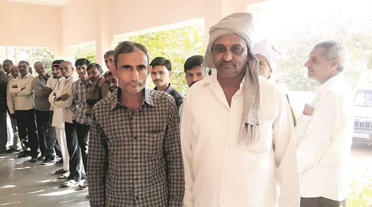 Ghansyambhai Padhariya (left) and Kanjibhai.
