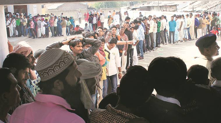 Villagers queue up to cast votes at Vekria village in Ahmedabad Tuesday. Javed Raja