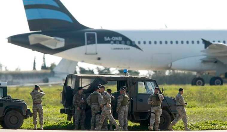 Maltese troops survey a hijacked Libyan Afriqiyah Airways Airbus A320 on the runway at Malta Airport, December 23, 2016. REUTERS/Darrin Zamit-Lupi   MALTA OUT