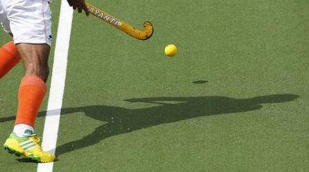 India's Singh casts a shadow during the men's gold medal field hockey match against Australia at the 2014 Commonwealth Games in Glasgow