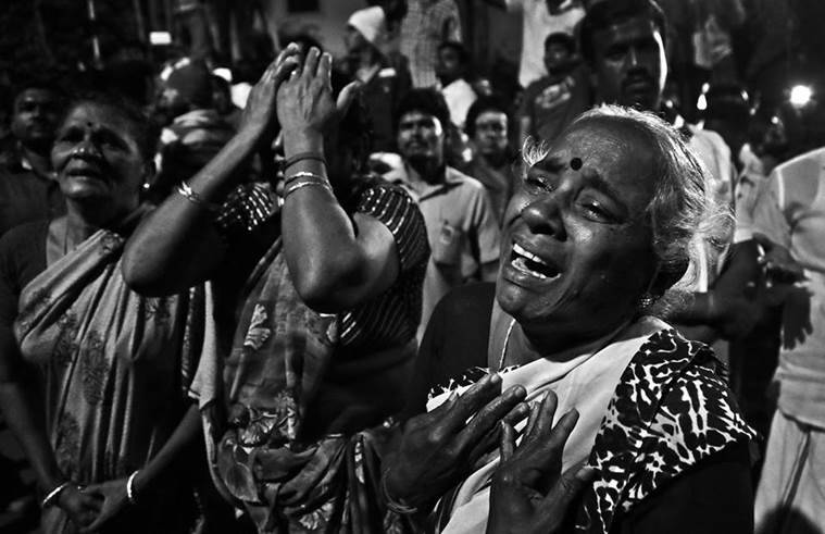 Supporters and followers mourn as Tamil Nadu CM Jayalalita's body was brought to her residence from Appolo hospital, Chennai. Express Photo/Nirmal Harindran