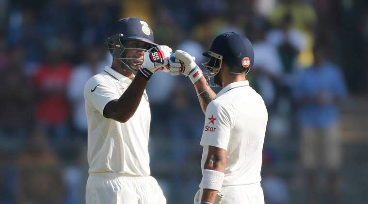 Indian captain Virat Kohli, right, celebrates with Jayant Yadav after he scored 50 runs on the fourth day of the fourth cricket test match between India and England in Mumbai, India, Sunday, Dec. 11, 2016. (AP Photo/Rafiq Maqbool)