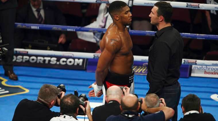 Britain's IBF Heavyweight champion Anthony Joshua, left, and Wladimir Klitschko stand on the ring after it was announced the two men will fight one another in 2017, following Joshua's win against American Eric Molina in Manchester, England Saturday, Dec. 10, 2016. (AP Photo/Dave Thompson)