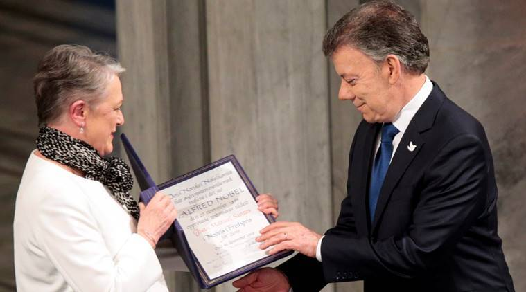 Nobel Peace Prize laureate Colombian President Juan Manuel Santos receives the medal and diploma from the Norwegian Nobel Committee member Berit Reiss-Andersen during the Peace Prize awarding ceremony at the City Hall in Oslo, Norway December 10, 2016. NTB Scanpix/Lise Aaserud/via REUTERS