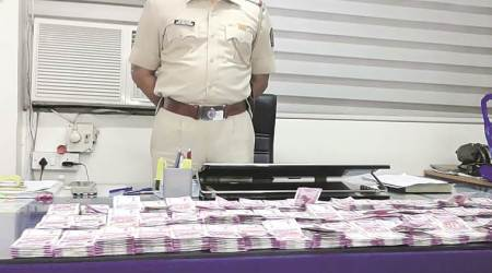 Rajkot factory owner detained, Rs 14 lakh new currency notes seized in Junagadh