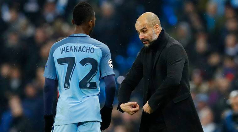 Manchester City manager Pep Guardiola speaks with Kelechi Iheanacho