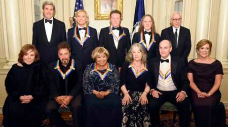 Teresa Heinz Kerry, front row, from left, Kennedy Center Honorees Al Pacino, Mavis Staples, Martha Argerich, James Taylor, and Kennedy Center President Deborah Rutter; rear row, from left, Secretary of State John Kerry, Kennedy Center Honorees Joe Walsh, Don Henley, and Timothy Schmit, and David Rubinstein are photographed following the State Department for the Kennedy Center Honors gala dinner, Saturday, Dec. 3, 2016, in Washington. (AP Photo/Kevin Wolf)