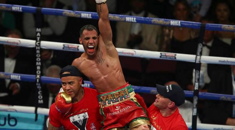 Britain's Khalid Yafai celebrates beating Luis Concepcion of Panama during the WBA super-flyweight title contest in Manchester, England, Saturday, Dec. 10, 2016. (AP Photo/Dave Thompson)
