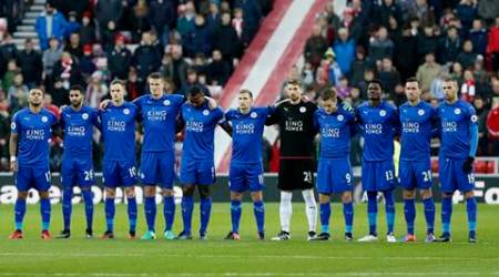 Leicester City players observe a minutes silence as respect for the victims of the Colombia plane crash containing the Chapecoense players and staff