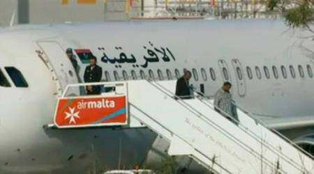 All passengers freed as Libya plane hijackers surrender, taken into custody