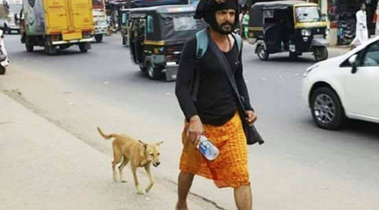 kerala stray dogs, kerala dog follows man, dog follows man on sabarimala pilgrimage, man's best friend dog, kerala stray dog follows man to sabarimala, kerala dog accompanies man on sabarimala pilgrimage, indian express, indian express news, trending, trending in india, viral