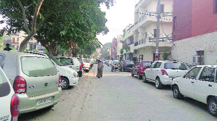 Vehicles parked on roads due to lack of space in Sector 40, Chandigarh, on Tuesday.  Kamleshwar Singh