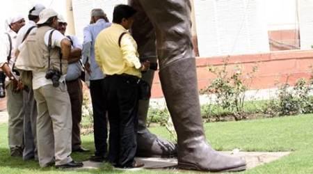 In his shadow: As the temperature climbs, the statue of Subhas Chandra Bose at Parliament House being put to very different use.  *** Local Caption *** Prem Nath Pandey