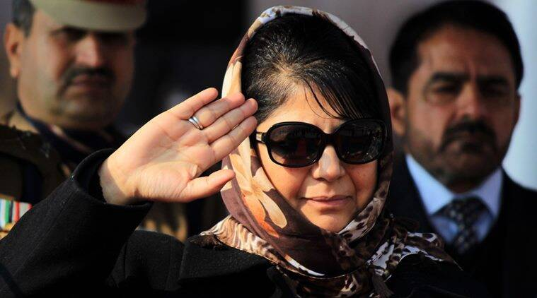 Mehbooba Mufti, the Chief Minister of Jammu and Kashmir, waves to the crowd as she inspects the new recruits of the Jammu and Kashmir Police while they take part during a passing out parade ceremony during in a passing out parade at a police training centre in Lethpora Awantipora.Express Photo by Shuaib Masoodi 14-12-2016