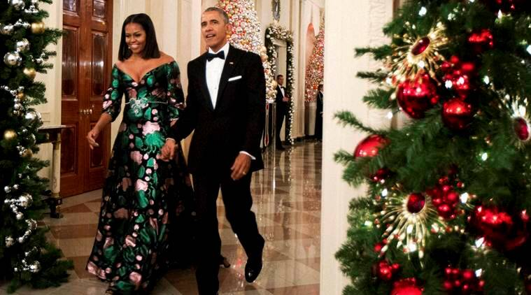 President Barack Obama and Michelle Obama arrive for a reception to honour recipients of the 2016 Kennedy Center Honors in the East Room of the White House in Washington. The first lady chose a Gucci dress for the event. (Source: AP)