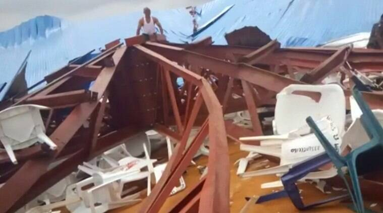 In this image made from video taken on Saturday, Dec. 10, 2016, local people survey the scene after a church roof collapsed in Uyo, Nigeria. Metal girders and the roof of a crowded church collapsed onto worshippers in southern Nigeria, killing at least 160 people with the toll likely to rise, a hospital director said Sunday. Mortuaries in the city of Uyo are overflowing from Saturday's tragedy, medical director Etete Peters of the University of Uyo Teaching Hospital told The Associated Press. (Ukeme Eyibio via AP)