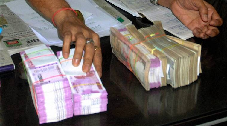 kheda, new currency seized, dakor, new currency notes, demonetisation, ahmedabad, rs 36 lakh seized, 2000 rs notes caught, chandkheda, income tax department, gujarat news, india news, indian express