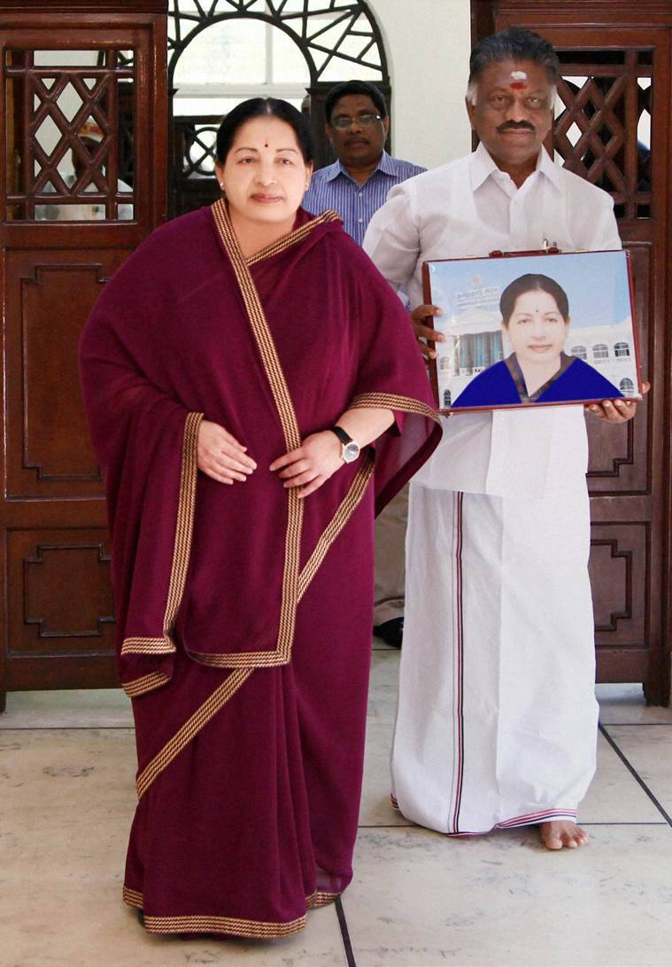 Chennai: Tamil Nadu Chief Minister J Jayalalithaa and Finance Minister O Panneerselvam entering the state Assembly for the presentation of the interim budget for 2016-17 in Chennai on Tuesday. PTI Photo/DIPR(PTI2_16_2016_000245A) *** Local Caption ***