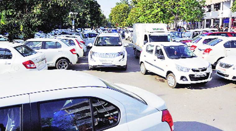 Parking chaos in Sector 17, Chandigarh, on Friday: (right) multilevel parking in Sector 17, Chandigarh, on Friday.   Sahil Walia