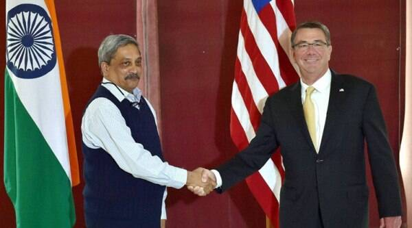 New Delhi: Defence Minister Manohar Parrikar shakes hand with US Secretary of Defense Ashton B. Carter before their meeting at South Block in New Delhi on Thursday. PTI Photo by Shahbaz Khan(PTI12_8_2016_000220A)