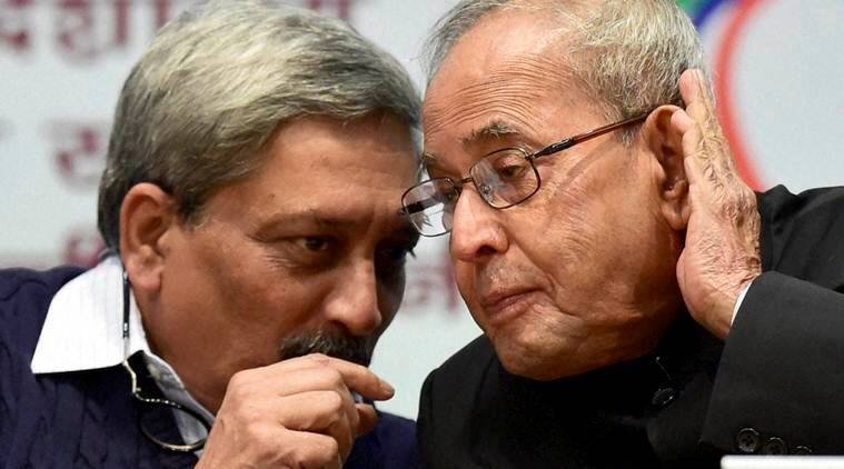 "New Delhi: President Pranab Mukherjee with defence Minister Manohar Parrikar at the fourth defence estates day lecture on the topic of "" Electoral Reforms for Stronger Democracy at DRDO Bhawan in New Delhi on Thursday. PTI Photo by Kamal Kishore (PTI12_8_2016_000112B)"