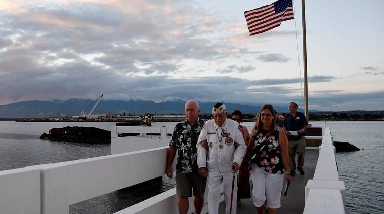 Pearl Harbor survivor Delton Walling walks with family members during a ceremony honoring the sailors of the USS Utah at the memorial on Ford Island at Pearl Harbor in Honolulu, Hawaii December 6, 2016. REUTERS/Hugh Gentry
