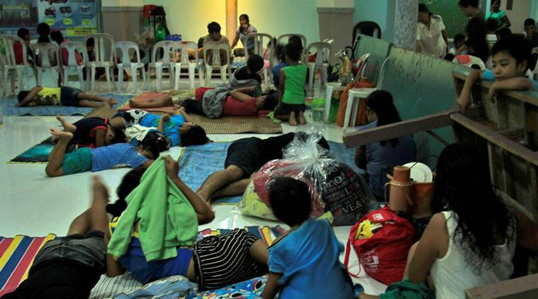 Philippines, typhoon, Typhoon Nock-Ten, Philippines typhoon, Christmas storm, Philippines Christmas storm, world news, indian express