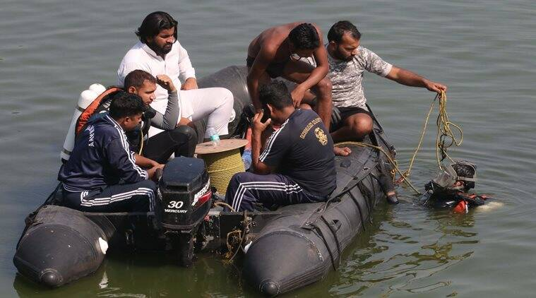 Boat capsizes in Powai Lake , 3 died and 5 saved . Search Operation by Navy and other teams are in progress Express Photo by Amit Chakravarty 24-12-16, Mumbai