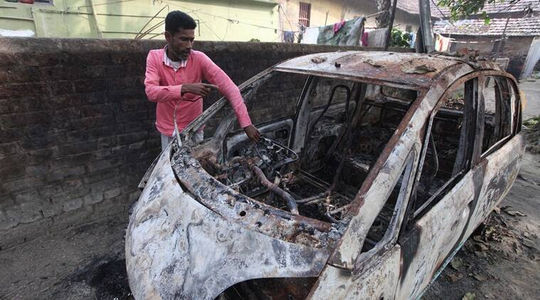 Shabir Mallik at shows his burn Nano car at Baisar para Express Photo by Partha Paul.28.12.16.Howrah