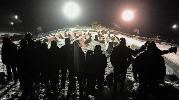 North Dakota borrows $7M more for pipeline protest costs