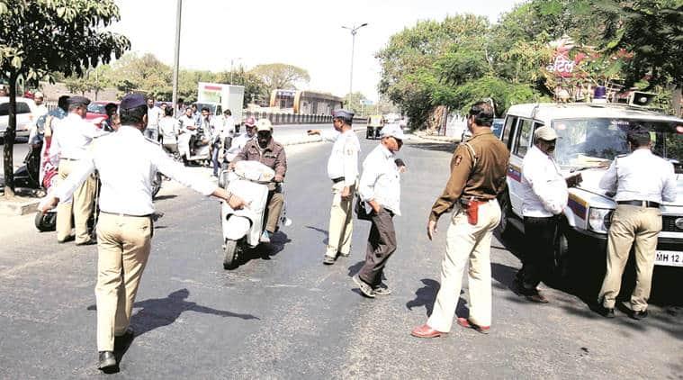 pune traffic police, pune police, pune traffic passport, indian express