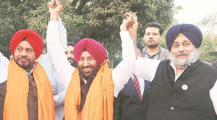 Sibia (centre) with Sukhbir Badal (right) after joining SAD, in Chandigarh on Saturday. Jasbir Malhi