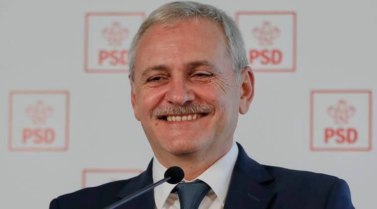 In this Dec. 7, 2016 picture Liviu Dragnea, the leader of the Social Democratic party smiles during a press conference in Bucharest, Romania. Romanians will vote in parliamentary elections on Dec. 11, a year after a massive anti-corruption drive forced its last prime minister Victor Ponta from power, media moguls were imprisoned and one of the leaders of the second biggest party quit over a graft probe.(AP Photo/Vadim Ghirda)
