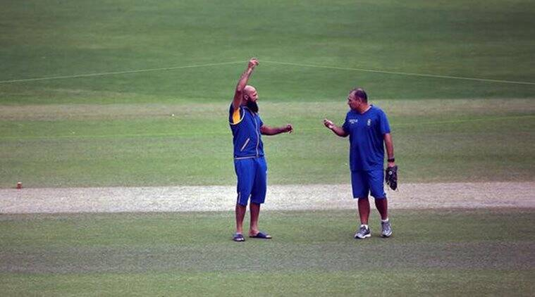 South Africa's captain Amla speaks with team coach Domingo during a practice session ahead of their fourth and final test cricket match against India in New Delhi